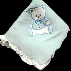 couvre-lit bleu brodé